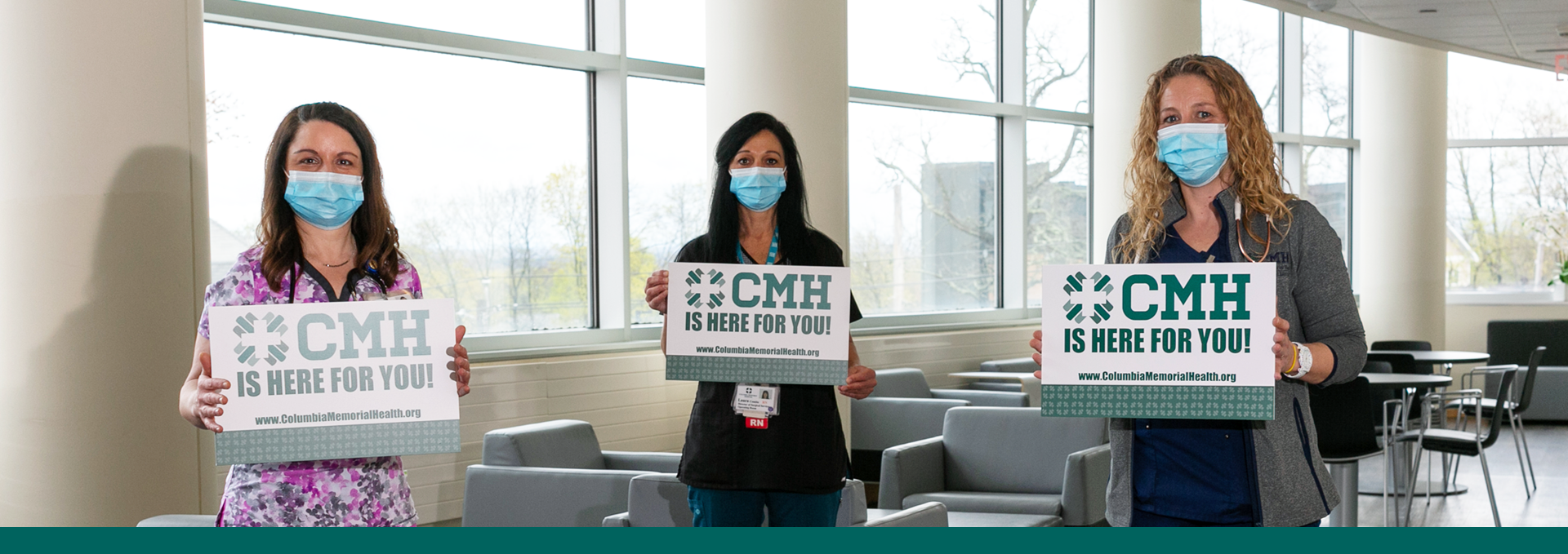Photo of three nurses with signs that say CMH is here for you!